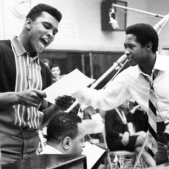 Muhammad Ali (center) originally named as Cassius Marcellus Clay, Jr is a renowned American former professional boxer