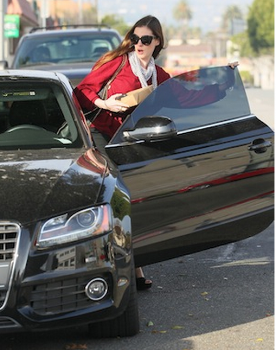 Hathaway has been photographed many a time behind the wheels of her black Audi A5