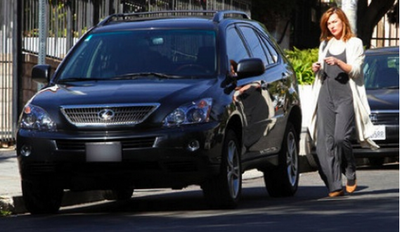Celebrity Milla Jovovich was spotted in Los Angeles in a rugged blue-black Lexus RX 350 which is a mid-sized SUV and people's favorite car.