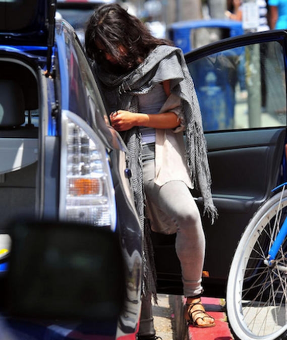 Michelle has been photographed many a times behind the wheels of her $40,000 black Toyota Prius.