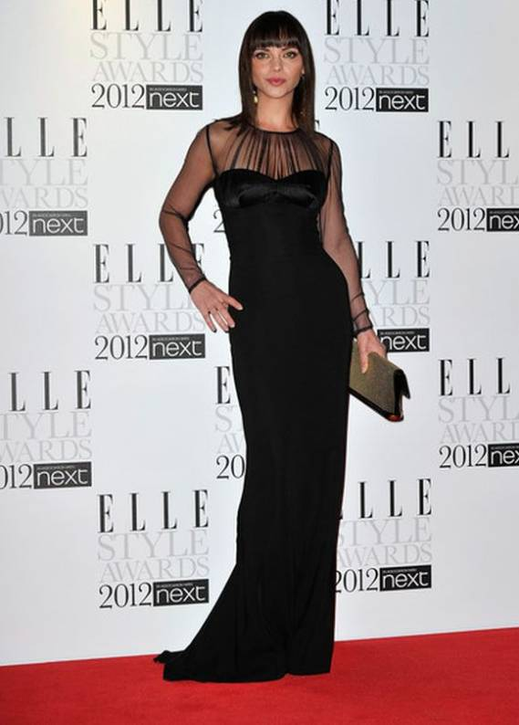 During the Elle-2012 event, actress Christina Ricci was looked slender, graceful and beautiful in a flowing black dress.