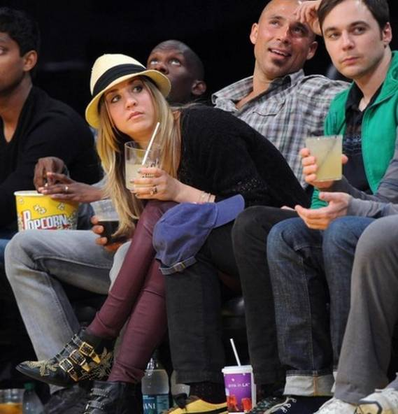Ms.Cuoco chose flat studded boots to along with her cowgirl attire as she attended a sporting event in a stadium.