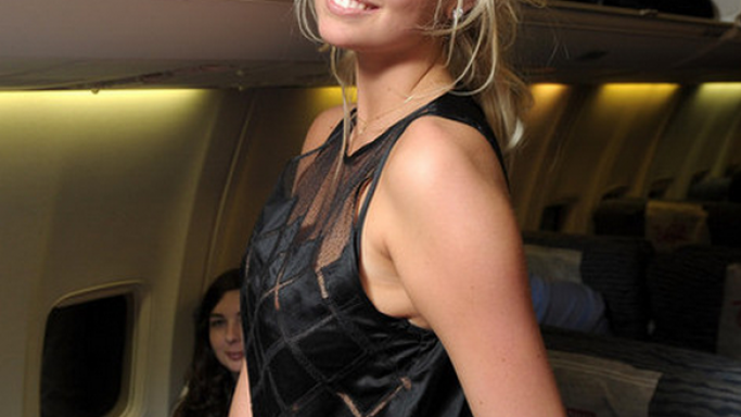 Kate Upton was spotted wearing the L'Agence silk-satin and mesh top when travelling in the flight for the shooting of '2012 Sports Illustrated Swimsuit Edition'.