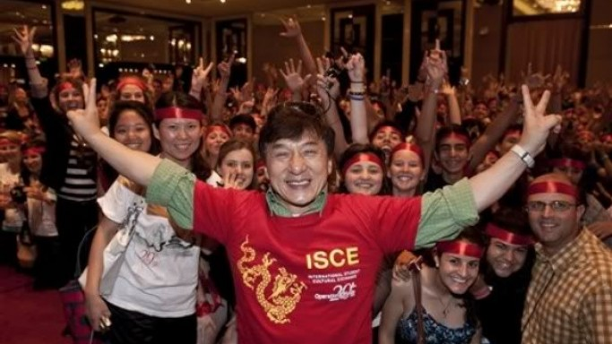Jackie Chan supports World smile foundation. In this picture  Jackie Chan poses with students during an event hosted by International Student Cultural Exchange  in Beijing
