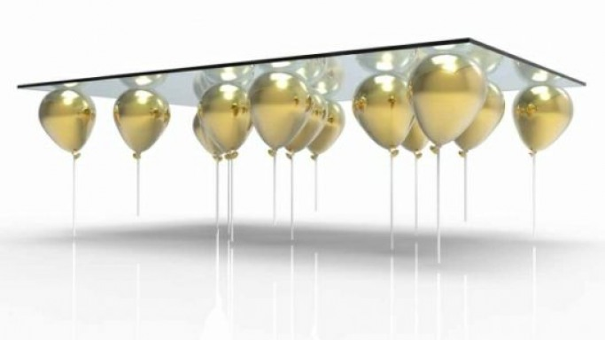 Bespoke coffee table suspended by small helium balloons