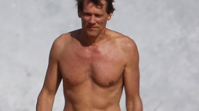 Kevin Bacon has been spotted having a good time being shirtless along the Hawaiian beach