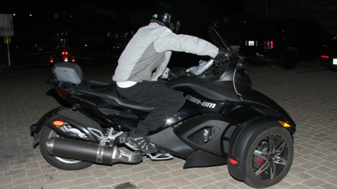 Rides his futuristic roadster