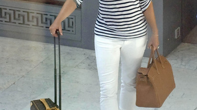 Elizabeth has been spotted with Louis Vuitton Monogram Canvas Pégase 60 number of times.