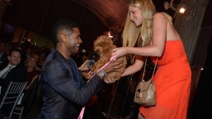 Recently Usher has got a new puppy after landing the highest bid in a auction